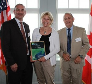 Candace Dolan receives GOMC Visionary Award at the Seashell Oceanfront Pavilion, Hampton Beach State Park from Ru Morrison, Executive Director, NERACOOS and Rene Pelletier, Assistant Director, Water Division, NHDES