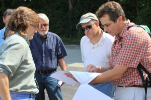 """James Houle, UNH Stormwater Center explains innovative stormwater practice, the """"Boulanginator,"""" plans to (R to L) Commissioner Burack, NH Representative William Baber, and Dover City Councilor Deborah Thibodaux."""